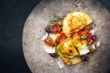Tortelli al branzino con pomodorini e olive